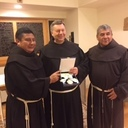 (L to R) Friars Jesus Gomez,  Robert Campagna, and German Tax. Friar Robert Holding the Medal of the Order of Santo Hermano Pedro